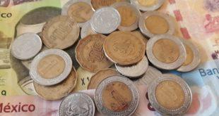 Incertidumbre por consulta del NAIM provoca 'turbulencia' al peso